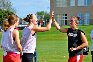Field Hockey Camps - Coaches High Fiving Player