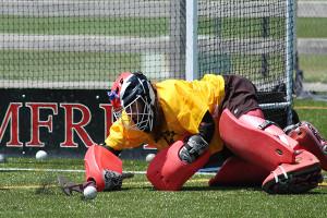 Field Hockey Camps - Goalie Lunging Save Pomfret School
