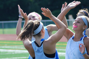 Field Hockey Camps - Campers High Fiving Revolution Rise