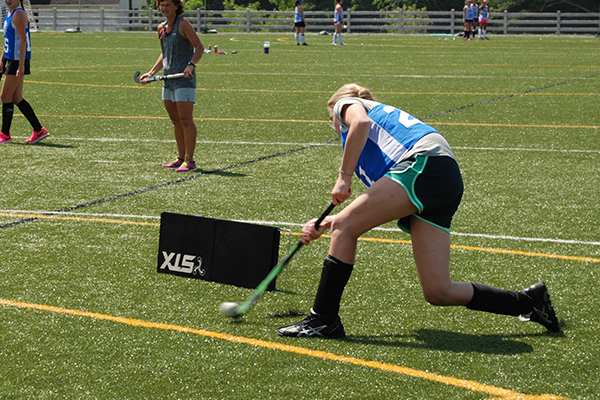 Field Hockey Player Making Contact