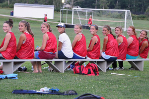 Field Hockey Camps - Smiling Campers on Bench